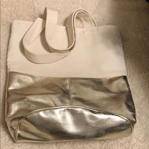Canvas tote with gold bottom.